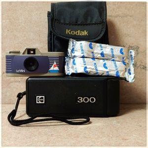 Lot of Vintage 110 Film Cameras and Case